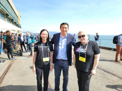 Andrew Yang (the middle) and Segway-Ninebot staff