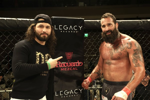 Gamebred Fighting Championship CEO Jorge Masvidal with main event winner Alex Nicholson on Friday, October 1st in Biloxi, Mississippi.